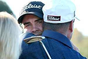 Troy Merritt gets hugs from his family after winning the Kodak Challenge.