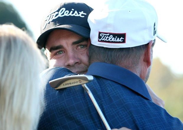 Troy Merritt gets hugs from his family after winning the Kodak Challenge.