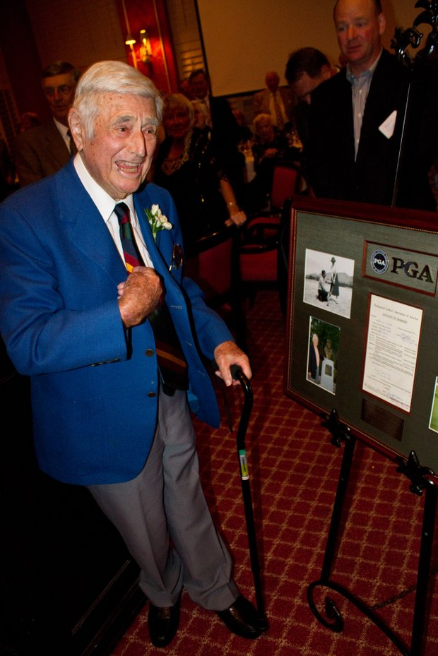 Errie Ball being presented with a plaque from the PGA.