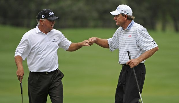 Mark O'Meara, left, celebrates a birdie with Nick Price of Zimbabwe during the final round of the Legends Division at the Liberty Mutual Legends of Golf.