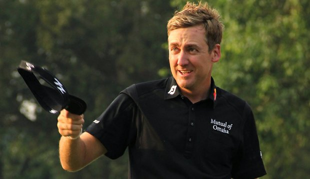Ian Poulter celebrates on the 18th hole after winning the UBS Hong Kong Open at The Hong Kong Golf Club.