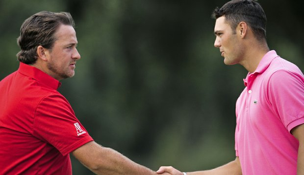 Graeme McDowell and Martin Kaymer shake hands during the Volvo Masters.