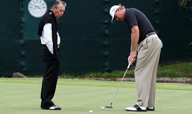 Gary Player gives guidance to Ernie Els, both major champions, on his putting Nov. 30 at Gary Player Country Club in Sun City, South Africa.