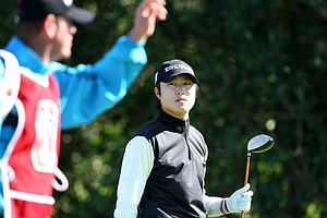 Seong Ho Lee talks with his caddie at No. 3 on Panther Lake. Lee is T5 after Thursday's round.