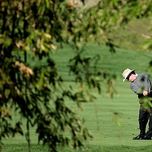 Briny Baird hits over the bamboo at No. 9 on Crooked Cat. Baird is T48 after Friday's round.