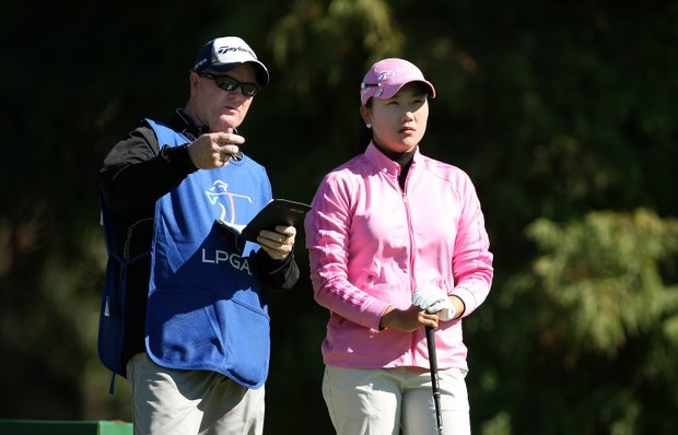Seon Hwa Lee talks with her caddie at No. 4. Lee is T3 after shooting a 73.