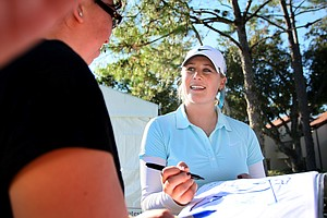 Amanda Blumenherst signs autographs after Saturday's round.