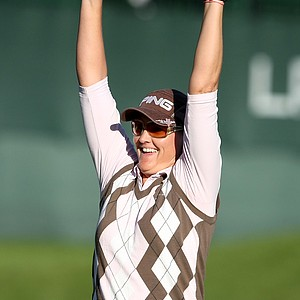 Maria Hjorth throws her hands in the air after winning the LPGA Tour Championship by one stroke.