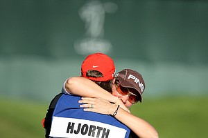Maria Hjorth hugs her caddie Mark Britton after winning the LPGA Tour Championship.