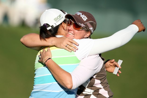Maria Hjorth and Amy Yang embrace after the final round. Hjorth beat Yang by one stroke.