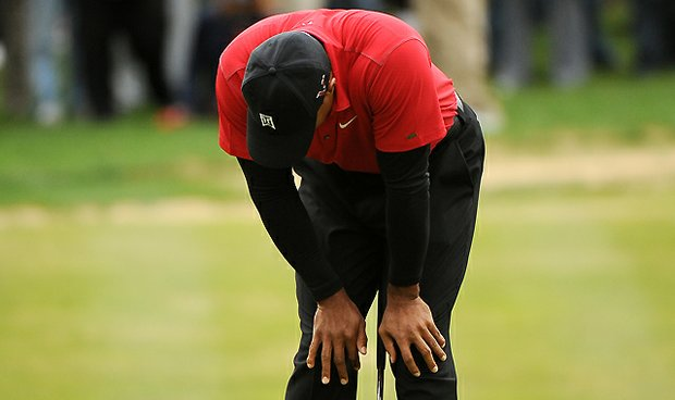 Tiger Woods reacts to missing a birdie putt on the seventh hole green during the final round at the 2010 Chevron World Challenge at the Sherwood Country Club.