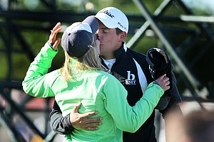 Scott Stallings kisses his wife Jennifer after securing his PGA Tour card.