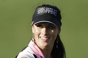 Maria Verchenova smiles during the opening round in Dubai.