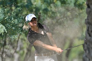 Carly Booth plays a hook shot out of the trees during Round 1 of the Dubai Ladies Masters.