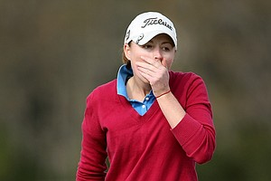 Lucy Nunn reacts to her putt at No. 9 on Champions Course. Nunn, an Arkansas graduate shot a 75.