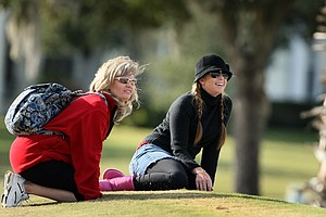 LPGA player, Paula Creamer, right, sitting with Stephanie Connelly's mom, Alicia, as they watch some of the action during the first round of LPGA Final Qualifying Tournament.