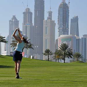 Florentyna Parker plays a shot towards the 6th green with the Dubai Marina skyline in the background during the second round of the Dubai Ladies Masters held at The Emirates Golf Club, Dubai, on Thursday, Dec, 9, 2010. (AP Photo/Stephen Hindley)