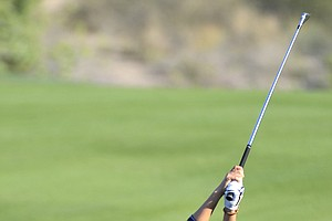 In-kyung Kim of South Korea plays a shot on the 14th fairway during the second round of the Dubai Ladies Masters golf tournament at the Emirates Golf Club, Dubai Thursday, Dec. 9, 2010. (AP Photo/Stephen Hindley)