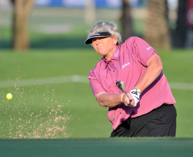 Laura Davies of England hits a shot from the bunker beside the 11th green during the second round of the Dubai Ladies Masters golf tournament at the Emirates Golf Club, Dubai, on Thursday, Dec. 9, 2010. (AP Photo/Stephen Hindley)