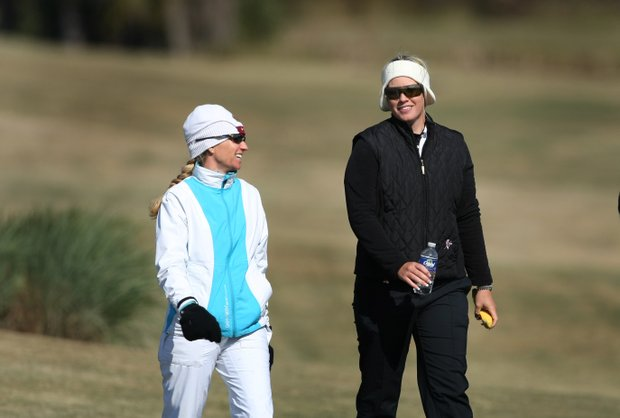 LPGA players Kris Tamulis, left, and Brittany Lincicome, walk the Champions Course watching several players during the second round.