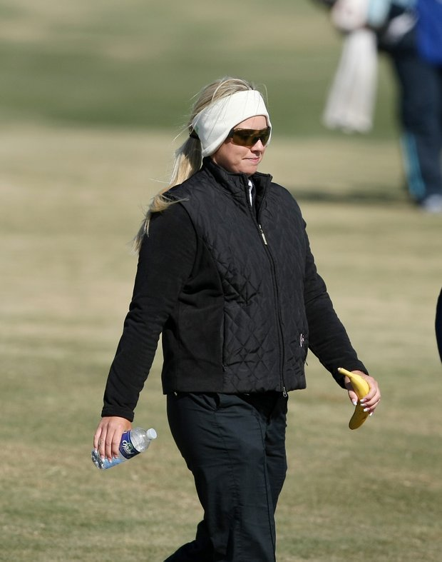 LPGA player Brittany Lincicome walks up No. 18 on Champions Course while watching several players during the second round.