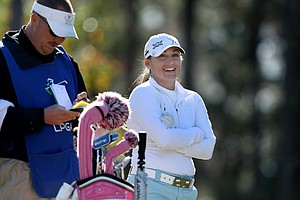 Kelli Kuehne shares a laugh with her caddie at No. 17 on Legends Course.