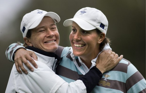 Danish golfer Iben Tinning, right, of team Europe celebrates with teammate Catriona Matthew of Scotland after a putt on the 14th hole during a match against the U.S. at the 2007 Solheim Cup.