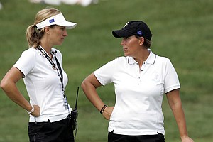 Europe team coach Catrin Nilsmark, left, of Sweden talks with player Iben Tinning of Denmark during the final day of practice for the 2005 Solheim Cup at Crooked Stick Golf Club in Carmel, Ind.