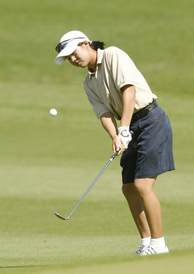At 15, Aree Song hits a short iron during the third round of the Kraft Nabisco Championship.