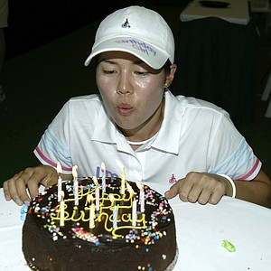 Aree Song celebrates her 18th birthday with a cake in the media center during the third round of the 2004 Chick-fil-A Charity Championship.