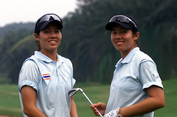 Naree Song, left, and Aree Song pose for photographs before they tee-off for the first round of the 2002 Women's World Amateur Team Golf Championship.
