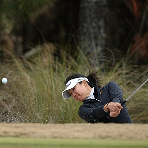 Angela Oh hits a bunker shot at No. 8 on Champions Course. Oh place T10 and earned her card.