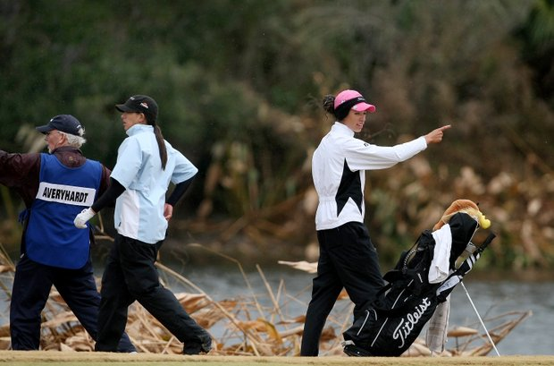 Shasta Averyhardt, right, along with Nicole Hage, center, try to figure out where Averyhardt's ball went into the hazard at No. 18.