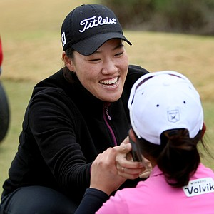 Jimin Jeong (facing camera) and Jin Young Pak, celebrate earning their cards during the final round of LPGA Final Qualifying Tournament.
