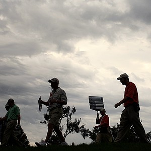 Officials with the Daniel Chopra, Stuart Appleby and Shaun Micheel group are silhouetted by storm clouds during the Arnold Palmer Invitational at Bay Hill, Friday, March 14, 2008.