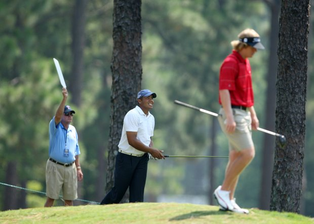 Jhonattan Vegas, center, watches his tee shot at the 18th hole during Wednesday's match play at the 2008 U. S. Amateur.