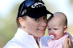 Annika Sorenstam with her baby girl Ava during the final round of the Annika Invitational at Reunion Resort in Reunion, Florida.