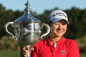 Yani Tseng poses with the Rolex Player of the Year trophy after the final round of the LPGA Tour Championship.