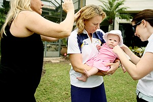 Annika Sorenstam's assistant helps get baby Ava ready while Annika's make-up artist touches up her hair. Sorenstam was photographed at her home in Lake Nona, Fla., for Golfweek For Her.