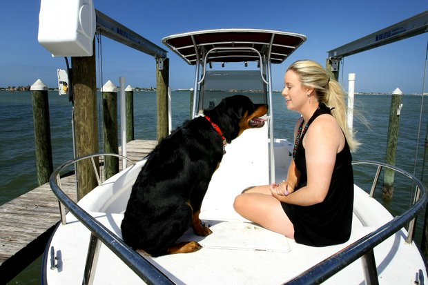 Brittany Lincicome enjoys a day on her boat along Florida's Gulf Coast with her dog, Major, during a Golfweek For Her photo shoot. (April 8, 2010)