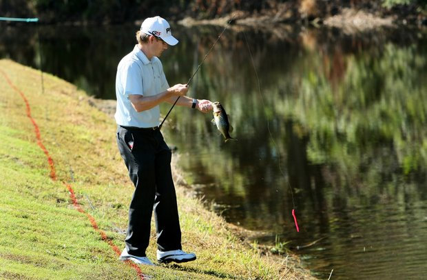 PGA Tour player Heath Slocum catches a fish during Wednesday's practice round at the Children's Miracle Network Classic.