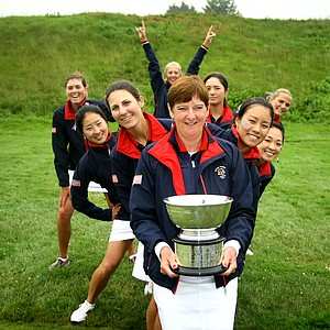 Captain Noreen Mohler and Team USA pose with the Curtis Cup trophy after the singles matches of the 2010 Curtis Cup at Essex County Club, June 13, 2010.