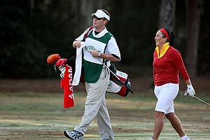 LPGA Commissioner Mike Whan leaves the office for a day to serve as caddie for Duramed Futures Tour player Lili Alvarez during the first round of the Florida's Natural Charity Classic. (March 19, 2010)