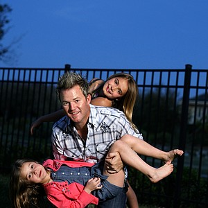 A few weeks before his first appearance at The Masters, PGA Tour golfer Brian Gay relaxes with daughters Brantley, 6 (bottom) and Makinley, 10, in the backyard of the family's home in Windermere, Fla. (March 24, 2010)