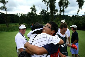 Yiming Liu embraces his son, Jim Liu, after the younger Liu defeated Justin Thomas, 4 and 2, in the finals of the U.S. Junior Amateur at Egypt Valley Country in Ada, Mich. He surpassed Tiger Woods as the youngest U.S. Junior Amateur champion. (July 24, 2010)