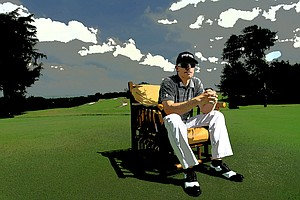 Relaxing near home, PGA Tour player Hunter Mahan grabs a seat on the practice tee at Dallas National Golf Club in Texas, taking a break from an interview for a Golfweek feature story. (June 8, 2010)