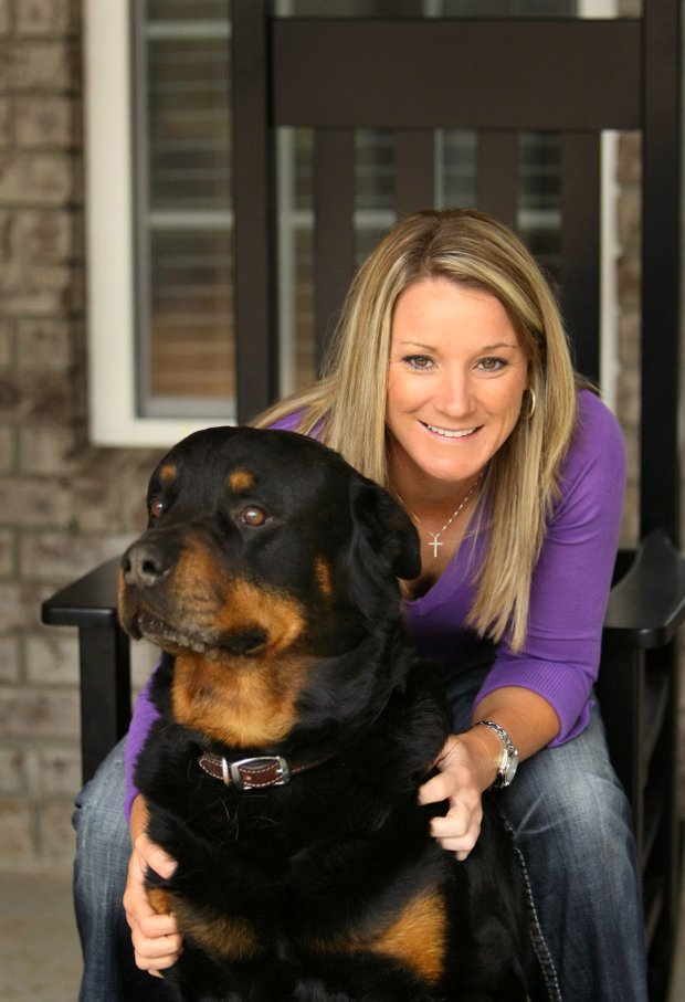 Kristy McPherson with her family dog, Max, at the home she bought her parents in Murrells Inlet, S.C.