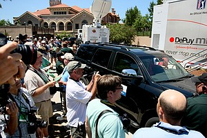 Photographers with several media outlets wait for Tiger Woods to exit the fitness trailer after withdrawing during the final round of The Players Championship at Sawgrass. (May 9, 2010)