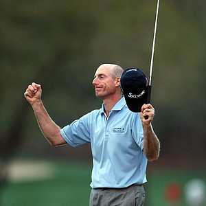 Jim Furyk raises his arms in victory after winning the Transitions Championship at Innisbrook Resort, March 21, 2010.