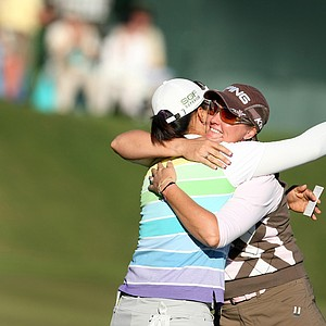 Amy Yang hugs Maria Hjorth at the conclusion of the LPGA Tour Championship.